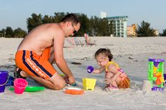 Father & Daughter Sandcastle. Father and daughter building a sandcastle on the public beach in Treasure Island, Florida Stock Image