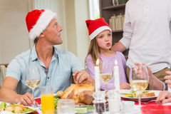 Father and daughter in santa hat at christmas time Stock Photos