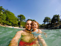 Father and daughter selfie in sea Stock Photography