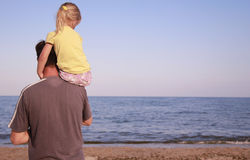 Father and daughter on the sea shore Stock Photo