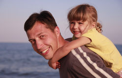 Father and daughter on the sea shore Stock Image