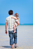 Father and daughter at shallow water Royalty Free Stock Photo