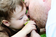 Father and Daughter Sharing. A father and daughter sharing an orange Stock Photo