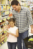 Father and daughter shopping in supermarket Royalty Free Stock Photo