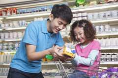 Father and Daughter Shopping in Supermarket, Looking at Juice Box Stock Images
