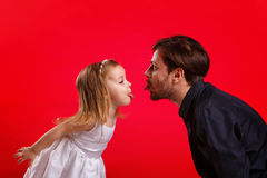 Father and daughter show tongues. Emotional games with your child. Family fun. The joy of communication Royalty Free Stock Photo