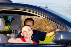 Father And Daughter Sitting In Mini Van Stock Photography
