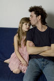 Father and daughter is sitting in the sofa Royalty Free Stock Photography