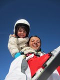 Father and daughter skiing Stock Photos