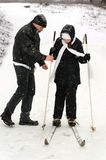 The father, the daughter and skis. Stock Photos