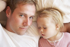 Father And Daughter Sleeping In Bed Royalty Free Stock Photography