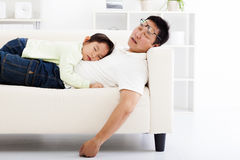 Father and daughter sleeping on the sofa Stock Images
