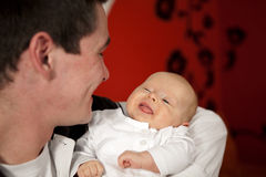 Father and daughter smiling at each other Stock Image