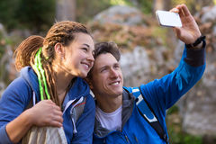 Father and Daughter smiling and taking Photo with Mobile Telephone. Family of Father and Daughter having Fun on Hike Spring Forest smiling and taking Photo Self Royalty Free Stock Photos