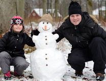 Father and daughter with snowman Royalty Free Stock Image