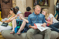 Father, daughter, and son rest in Louvre, Paris, France Stock Photography