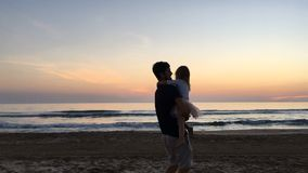 Father and daughter spinning around at sunset. stock video footage
