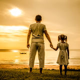 Father and daughter standing at the beach Royalty Free Stock Images