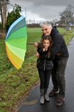 Father and daughter in stormy weather Stock Image