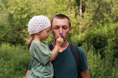 Father and daughter in the summer forest Stock Photos