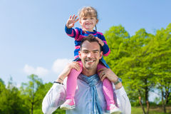 Father and daughter on a summer meadow Stock Photography