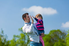 Father and daughter on a summer meadow Royalty Free Stock Image