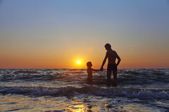 Father and daughter at sunset Royalty Free Stock Images