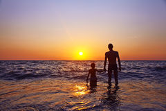 Father and daughter at sunset Royalty Free Stock Photo