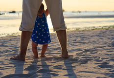Father and daughter on the  sunset beach Stock Image