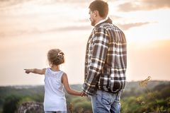 Father and daughter at sunset, family values stock images