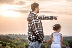 Father and daughter at sunset, family values royalty free stock photography