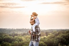 Father and daughter at sunset, family values royalty free stock image