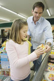 Father And Daughter In Supermarket Royalty Free Stock Image