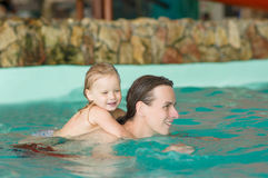 Father with daughter swim in aqua park Stock Photography