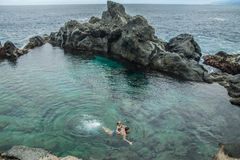 Father and daughter swimming in the natural swimming pool Charco De La Laja, at the north of Tenerife Stock Image