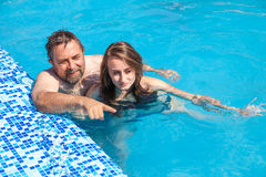 Father and daughter swimming in the poo Royalty Free Stock Photo