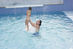 Father and daughter in the swimming pool Royalty Free Stock Photo