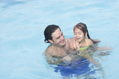 Father and daughter in the swimming pool Royalty Free Stock Images