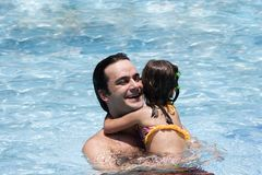 Father and daughter in Swimming pool Royalty Free Stock Photos