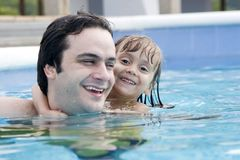 Father and daughter in Swimming pool Royalty Free Stock Photo