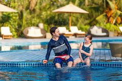 Father and daughter at swimming pool Stock Photography