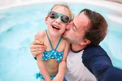 Father and daughter at swimming pool Royalty Free Stock Images