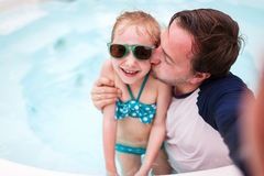 Father and daughter at swimming pool Royalty Free Stock Photo