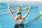 father and daughter in the swimming pool Stock Images