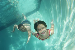 Father And Daughter Swimming Underwater Royalty Free Stock Photo