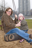 Father and daughter on swing Stock Photography