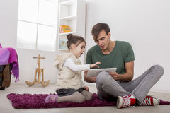 Father and daughter with a tablet Stock Image