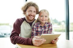 Leisure online. Father and daughter with tablet having fun at leisure Royalty Free Stock Photography