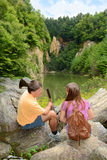 Father and daughter talking on a hiking trip. Stock Photo