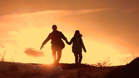 Father and daughter teamwork happy family tourists silhouette concept jump up hold hands . team dad and daughter on stock video footage